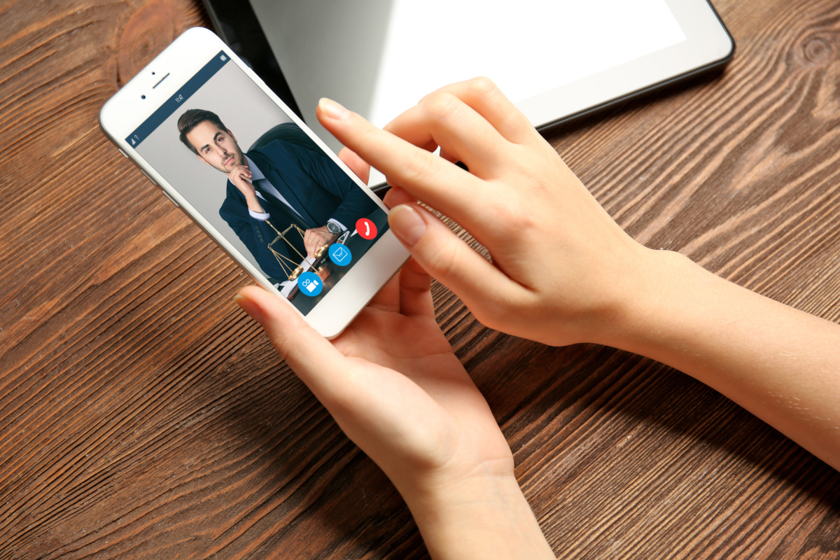 Face-to-face on mobile phone with the lawyer